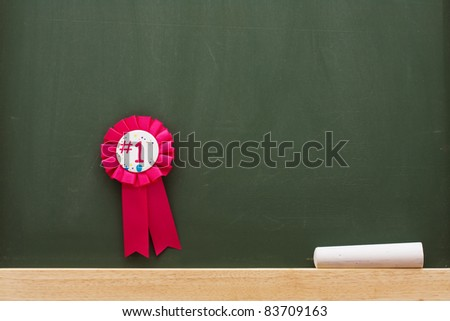 Award and chalk on a chalkboard with lots of copy space, Award winning education