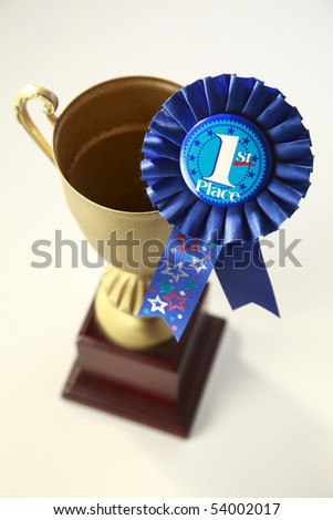 award badge and trophy on the plain background