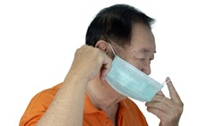 Awareness concept to ware mask, The oldman shown how correct way of wearing medical face masks to protect from coronavirus(covid-19), side view portrait isolated on white background.