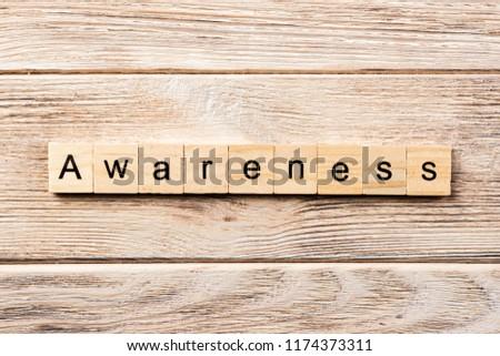 awareness word written on wood block. awareness text on table, concept.