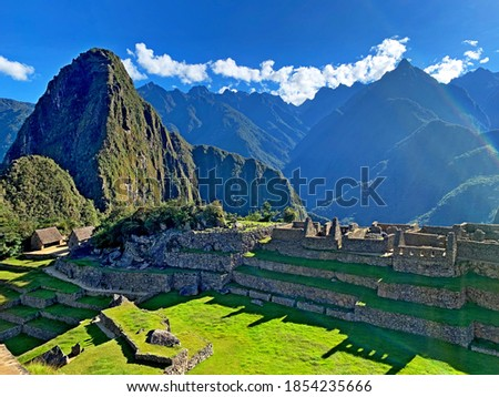 Awe Machu Picchu legendary lost city of Inca Empire in Peru, Andes mountains. Majestic historical complex landmark, ancient stone buildings, green grass terraces , Inca Trail in Huayna Picchu mount. Stock photo ©