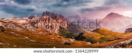 Awesome alpine highlands during sunset. Incredible view of Dolomites Alps. landscape of Tre Cime di Lavaredo National park. Picture of wild area. Amazing Nature Landscape. Fantastic scene in summer #1364228999