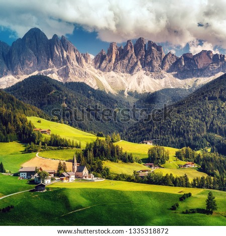 Photo of  Awesome alpine Landscape in sunny day. Santa Maddalena.  Is one of the most popular photo spot of Dolomite. Famous World place. Dolomites Alps. Italy.  Amazing Natural background. Postcard