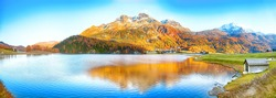 Awesome autumn panorama of Silvaplana lake and Surlej village. Location: Silvaplana, Maloya district, Engadine region, Grisons canton, Switzerland, Europe.