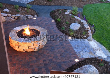 Awesome backyard with fire pit and illuminated paver patio