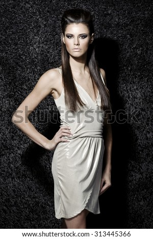 Stock Photo Awesome caucasian sexy fashion model with stylish hairstyle, long legs, full lips, perfect skin, wearing sparkling cocktail dress, standing near shiny black carpet, beauty photoshoot, retouched image