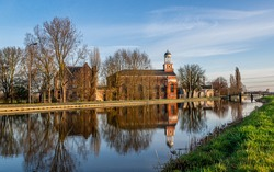 Awesome Church Hodenpijl in Schipluiden in the Netherlands with beuatiful reflection in the water, very sustainable