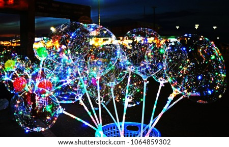 awesome clear balloon install LED lighting inside so attractive in the dark  and popular thing for decorated outdoor party at night so beautiful pattern for abstract background