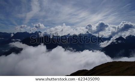 Awesome cloudscape beneath on the mountains in the valley of Lech in Austria #623435090