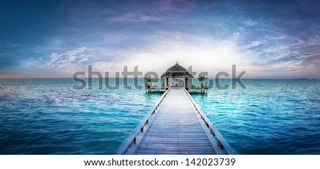 Awesome dreamy sunset over the jetty in the Indian ocean | Maldives