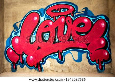 awesome graffiti of the word love sprayed on a wall  #1248097585