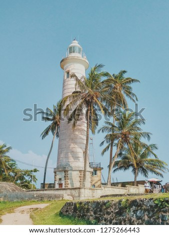 Awesome lighthouse with awesome summer palm trees
