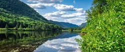 Awesome summer view from a verdant hill in Jacques Cartier National Park, Quebec province, Canada