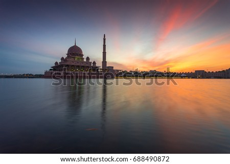 Awesome sunrise rising at Putra Mosque, Putrajaya, Malaysia with reflection of the lake and smooth water due to long exposure. #688490872