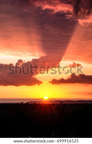 Awesome sunset at evening time with dark orange and red clouds #699916525