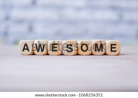 AWESOME word written on wood block #1068236351