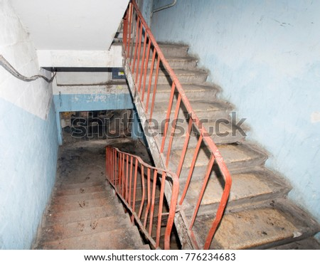 "Awful and dirty interior of staircase in apartment building with cheap apartments. This type of building is called ""gostinka"". Usually residents of such houses are poor. Ghetto. Russia, Vladivostok. #776234683"