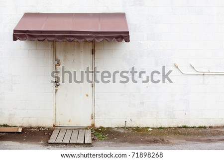 awning over door grungy wall