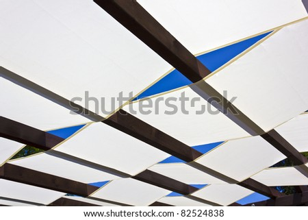 Awning. White tents on a wooden base for sunscreen