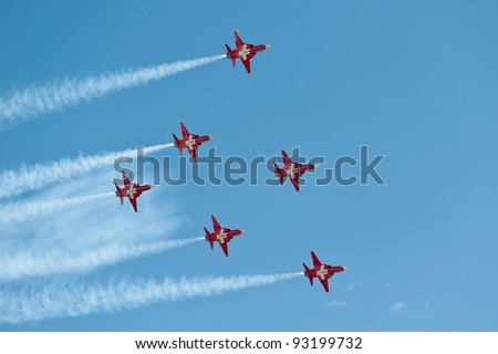 AXALP, SWITZERLAND - OCTOBER 11: Patrouille Suisse during training before Axalp Swiss Air Force Live Firing Demo on October 11, 2011 in Axalp, Switzerland - stock photo