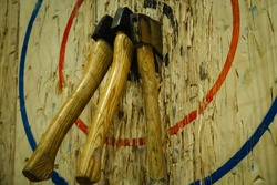 Axe stick in to the wood bull's eye in throwing axe sport