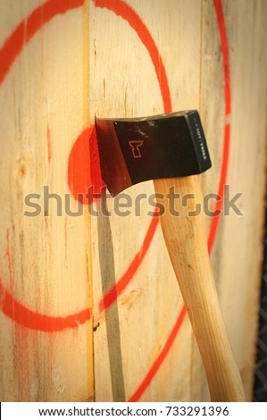 Axe stuck in a wooden target