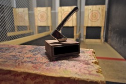 Axe throwing trophy on display at an indoor axe throwing hall that holds competitions for both recreational and competitive leagues.