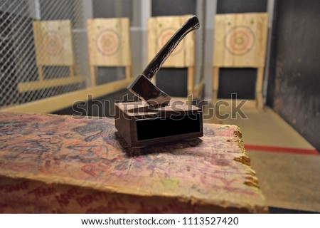 Axe throwing trophy on display at an indoor axe throwing hall that holds competitions for both recreational and competitive leagues. #1113527420