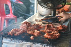 Ayam bakar is a indonesian dish, consisting of charcoal-grilled chicken. Ayam bakar literally means