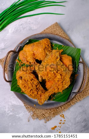 Ayam goreng kremes or Crispy fried chicken. one of the popular side dishes in Indonesia. selective focus. Top view.  Stock fotó ©