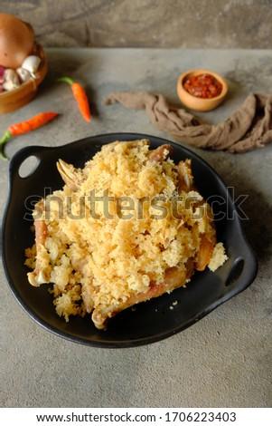 Ayam Goreng Kremes. Popular fried chicken dish from Jogjakarta, deep-fried whole chicken and topped with seasoned crisps. Stock fotó ©