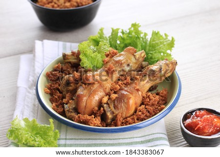 Ayam Goreng Kremes. Popular Fried Chicken dish from Jogjakarta, Deep-Fried Whole Chicken and Topped with Fried Seasoned Crispy Flour Batter  Stock fotó ©