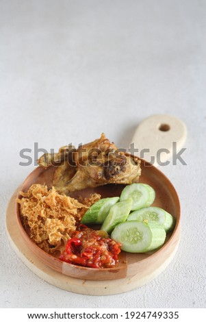 Ayam Goreng Kremes. Popular fried chicken dish from Jogjakarta, deep-fried whole chicken and topped with seasoned crisps. Selective focus Stock fotó ©