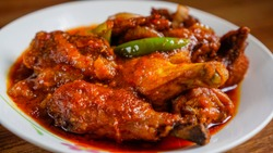 Ayam masak merah is a Malaysian traditional dish. This literally means chicken