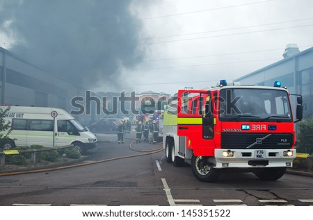 Aylesbury, Uk - July 2: Fire Fighters Attend A Large Industrial Fire That Has Broken Out In An Industrial Unit Complex On July 2, 2013 In Aylesbury