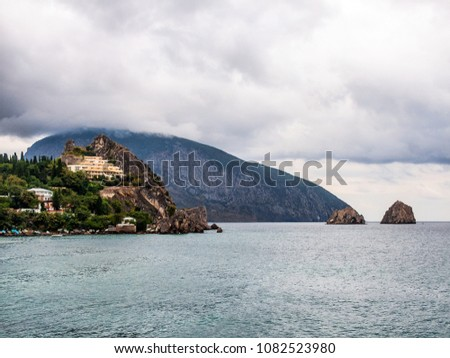 Ayu-Dag (Bear Mountain) is a symbol of the Crimea. View in cloudy weather. In the foreground on the left is the village of Gurzuf. Black Sea.