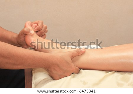 Ayurvedic spa foot leg massage close up