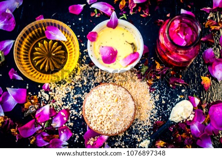 Ayurvedic ubtan of Rose water,gram flour,oats and rose petals or face pack on wooden surface helps in removing pimples,dead skin and smooth  the dried skin and give a moisture.