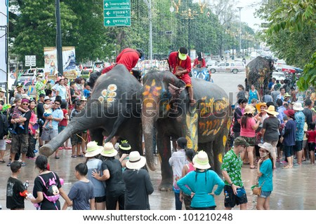 AYUTTAYA, THAILAND - APRIL 14: Songkran Festival is celebrated in a traditional New Year's Day from April 13 to 15, with the dancing by elephants on April 14, 2012 in Ayuttaya, Thailand.