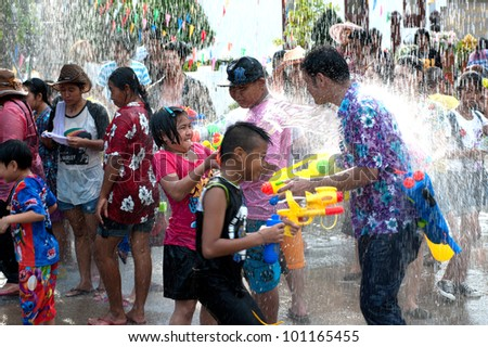AYUTTAYA,THAILAND-APRIL 13: unidentified People celebrating Songkran (Thai new year / water festival) child and his water gun on road April 13, 2012 in Ayuttaya, Thailand.