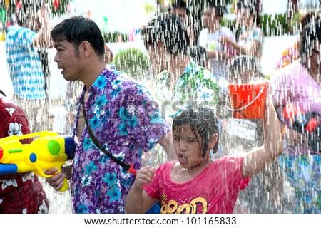 AYUTTAYA,THAILAND-APRIL 13: unidentified People celebrating Songkran (Thai new year / water festival) children splashing water to other peoples  April 13, 2012 in Ayuttaya, Thailand.