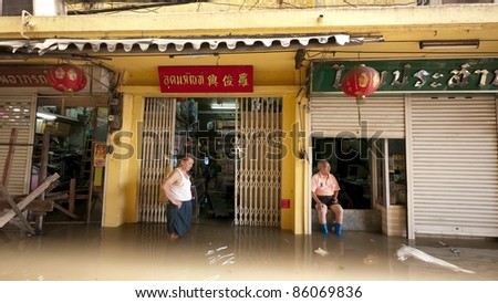 AYUTTAYA, THAILAND - OCTOBER 5: Flooded shops and shop owners during the monsoon season in Ayuttaya, Thailand on October 5, 2011.