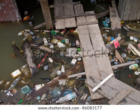 AYUTTAYA, THAILAND - OCTOBER 5: Garbage piling up at a flooded street during the monsoon season in Ayuttaya, Thailand on October 5, 2011.