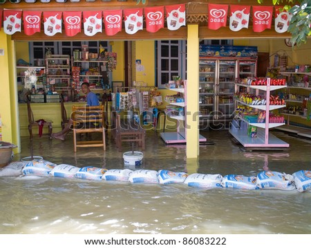 AYUTTAYA, THAILAND - OCTOBER 5: Local shop flooded during the monsoon season in Ayuttaya, Thailand on October 5, 2011.