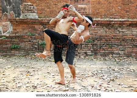 AYUTTHAYA - FEB 18: Fighters take part in a Muay Boran demonstration at Wat Worachet on Feb 18, 2013 in Ayutthaya, Thailand. Muay Boran refers to Thai kickboxing before modern rules were introduced.