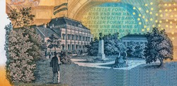 Az Ideiglenes Magyar Kepviselohaz Pesten (The Provisional Assembly of Hungary in Budapest) building with flag, trees, strolling couples, and statue of bust. Portrait from Hungary Banknotes.