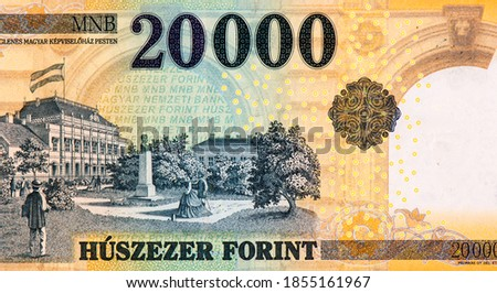 Az Ideiglenes Magyar Kepviselohaz Pesten (The Provisional Assembly of Hungary in Budapest) building with flag, trees, strolling couples, and statue of bust. from Hungary 20000 Forint 2004 Banknotes.  Stock fotó ©