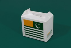 Azad Kashmir flag on white box with barcode and the color of nation flag on green background. The concept of export trading from Azad Kashmir, paper packaging for put products.