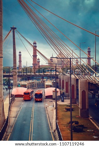 Azadi Chowk lahore  Pakistan The View  Two Red Bus And Masque  Minar