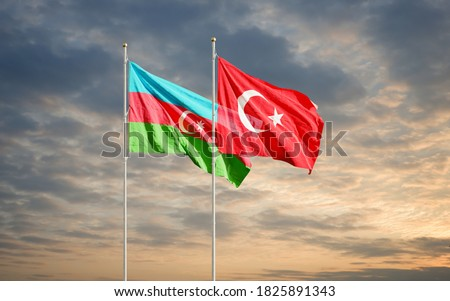 Azerbaijan and Turkey flags waving in the dawn sky. Symbol of international agreement and support during Karabakh war conflict with Armenia. 3D rendering
